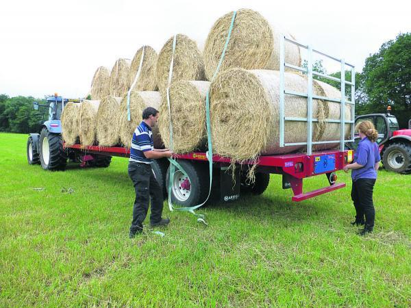 Kevin and Melissa secure the bales of hay before they are taken to the barn