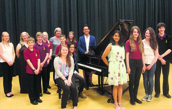 Pianists at Royal Wootton Bassett Academy with the new grand piano
