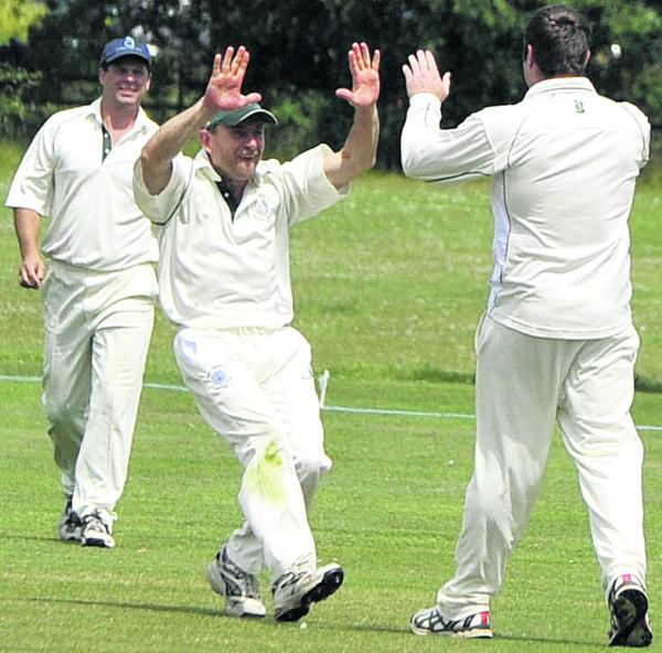 The Wiltshire Gazette and Herald: Great Bedwyn celebrate a Devizes wicket. Pictured (l-r) are Neil Maycock, Chris Lailey and bowler Robert Palmer