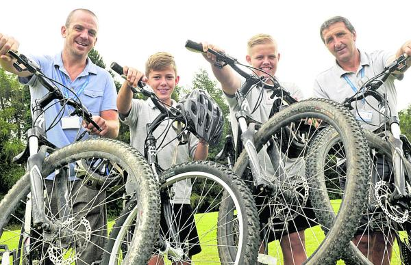 Pupils and staff from Downlands School in Devizes are taking part in  a national bike challenge riding through the Alps. From left are staff member Mike Rees-Lee, pupils Bailey S