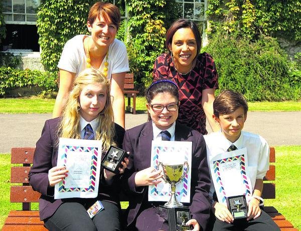Devizes School poetry winners Sophie Wilson, left, Lucy Maher and Ben Brown with teachers Helen Carpenter, left and Susanna Mountcastle