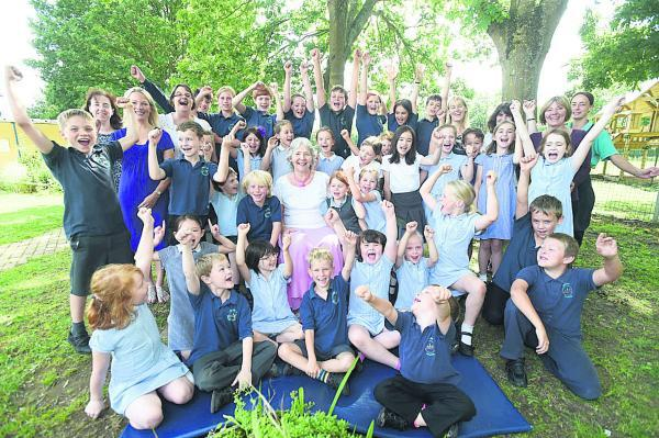A rousing send-off for Debbie Short, centre, by pupils and staff at Seagry School. Picture by Diane Vose