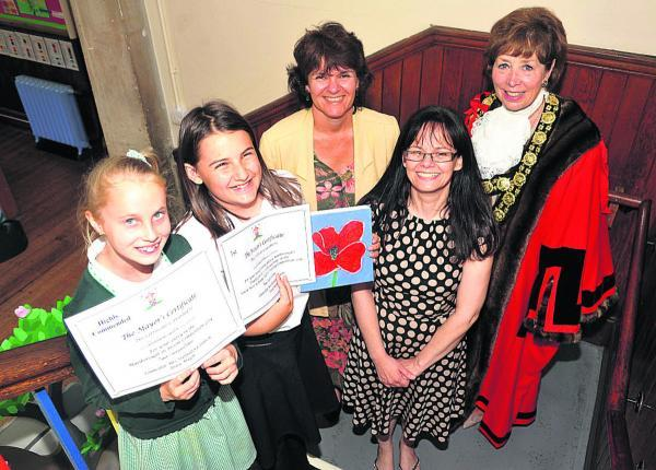 Highly commended pupil Christen Watts, left, and winner Arwen Crook with Caroline Spindlow, art leader Becky Ambrosini and mayor Marian Hannaford-Dobson(vs603) By vicky scipio