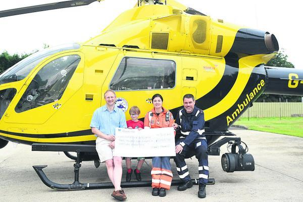 Stuart Foulstone and his son William with air ambulance paramedic Joanne Munday and PC Nigel Gilbert