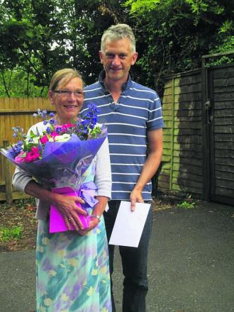 Sue Allsop, who is retiring from All Cannings community shop, with shop chairman Paul Oakley