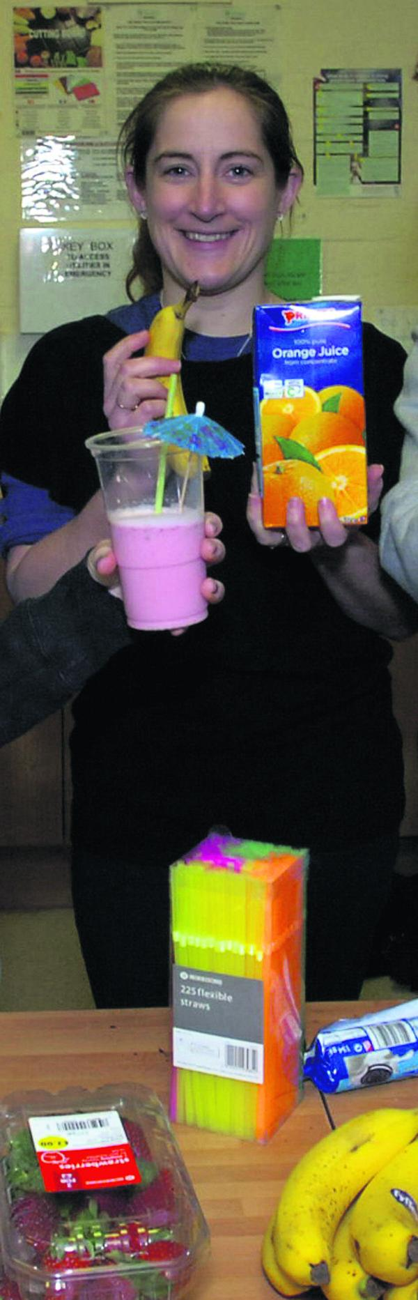Sally Willox during a smoothie-making  session with youth centre members in 2011