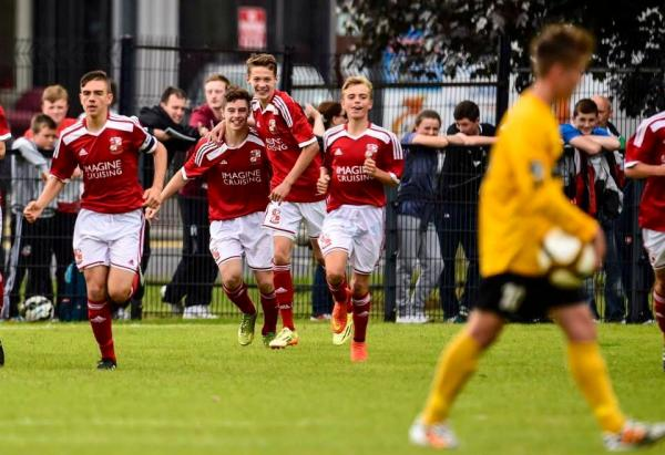 Swindon Town celebrate a goal against County Antrim at the Milk Cup
