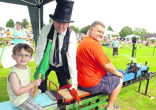 All the fun of the fete, including a mini steam engine, at Seend  back in 2012