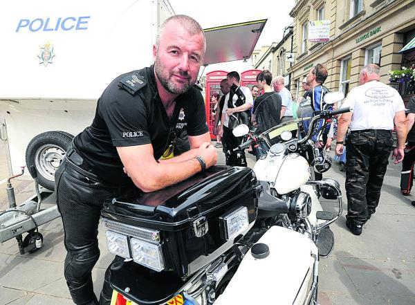 Sgt Craig Hardy with a police Harley-Davidson at the annual Calne Bike Meet. Picture by Paul Morris