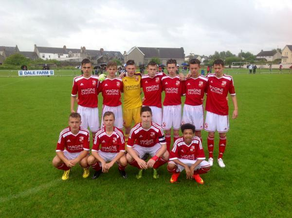 The Swindon Town side line up before their clash with Dundalk at the Milk Cup