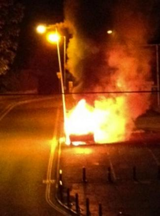 The car alight at Skurrays in George Lane, Marlborough