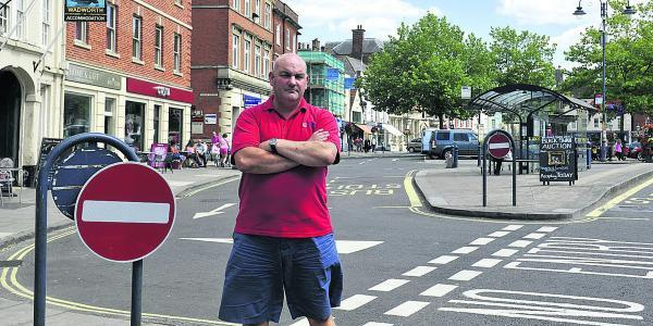 Neil Fautley is angry about cars using the one way only road the wrong way outside his shop