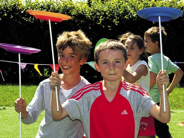 Daniel and Lewis try their hand at circus skills during the fun day                (PM1376) By Paul Morris