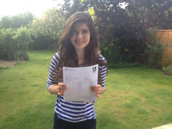 Izzy Payne celebrates getting three A* in English literature, English language and Classical Civilisation