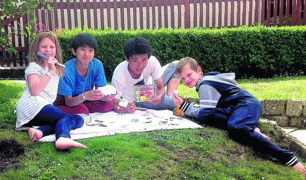 Naoto and Hiroki from Japan relaxing on a summer evening with Nancy and Ted Nicholls from Marlborough