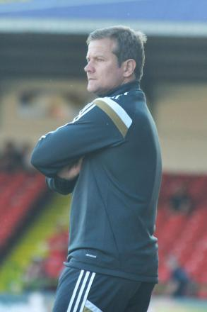 Mark Cooper is looking forward to pitting his Swindon Town side against Championship Brighton & Hove Albion