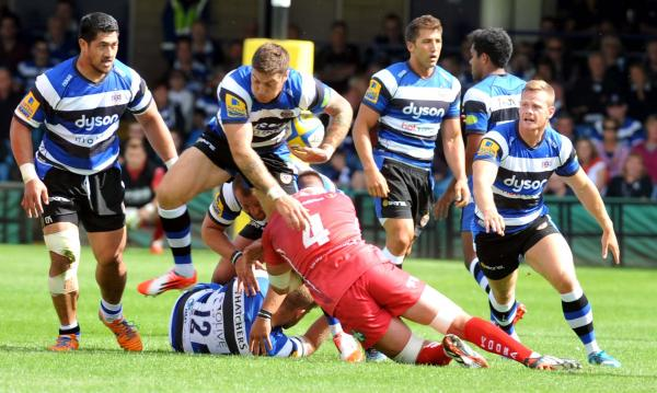Matt Banahan piles through the Scarlets defence yesterday (Photo: Bob Ascott)