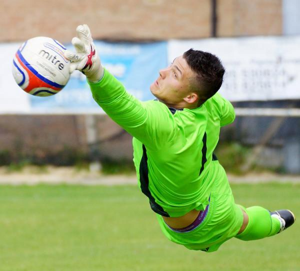 Calne Town goalkeeper Jamie Bartlett pulls off a save during last weekend's draw with Cheddar (Picture: Dave Gillett)