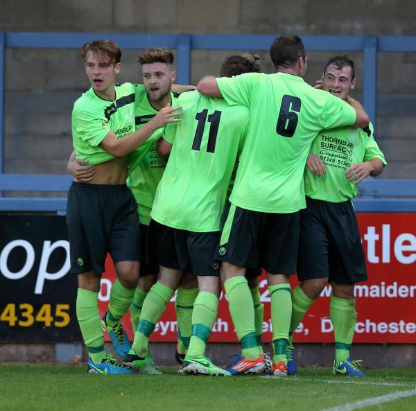 Chippenham's players celebrate Luke Ballinger's winner at Dorchester (Picture by Chippenham Town FC)