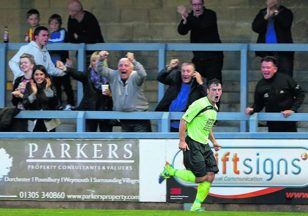 Luke Ballinger starts the celebrations in front of the visiting support after scoring the winner at Dorchester on Tuesday (Picture: Chippenham Town FC)