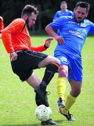 Woottton Bassett Town Development's Rich Clark (right) challenges Trowbridge Wanderers' Jordan Pinder last weekend