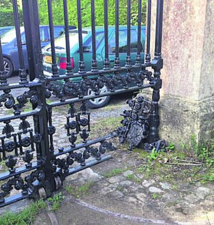 The damage caused to the restored gates at Quakers Walk