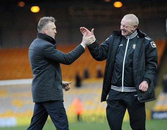 Crewe assistant Neil Baker celebrates with his boss Steve Davis
