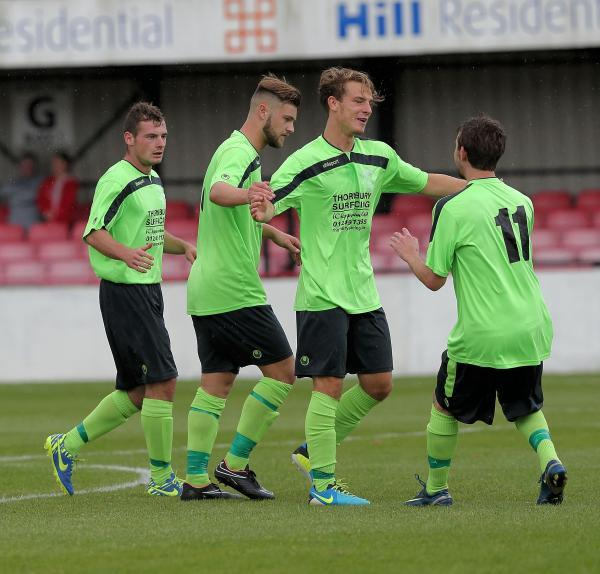 Alex Ferguson (second from right) celebrates scoring Chippenham Town's third goal in Saturday's win at Histon