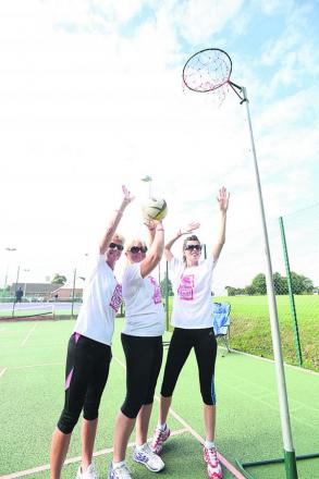Trudie Procter, Nikki Chambers and Ella Harding shoot hoops at Devizes Sports Club. Picture by Diane Vose