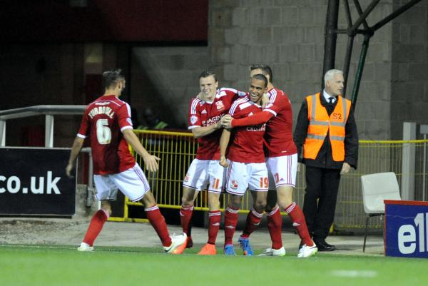 Louis Thompson celebrates his first goal of the season with Brad Smith, Andy Williams and Jordan Turnbull