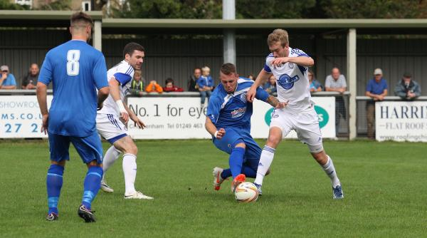 Chippenham Town's Ben McCready challenges Hungerford Town's James Pilling during his side's 1-0 defeat at Hardehuish Park yesterday (Picture: Robin Foster)