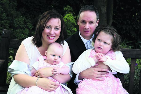 Louise Duman and Richard Dicks with their daughters Lois, six months, and Ella, five, who has a complex genetic medical condition
