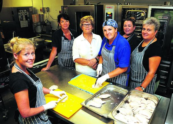 Laura Ellison, front, with Marie Hogan, Sue Brady, Kim Good, Laura Spares and Linda Smith at Sue Brady Catering, preparing extra meals for the new school term. Picture by Paul Morris