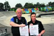 PCSO Shaun Redmond and PC Hazel Anderson with the posters highlighting the dangers of nitrous oxide