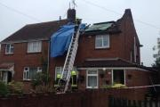 Firefighters at Littlejohn Avenue, Melksham, today after the lightning strike and fire. Picture by Amber Hicks