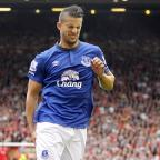 The Wiltshire Gazette and Herald: Everton's Kevin Mirallas pulled up injured during the Merseyside derby