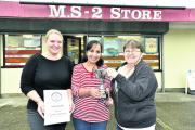 Shelly Hartnoll from the Gazette & Herald presents the award to MS2 store owner Renu Sharma and sales assistant Lorraine Payne