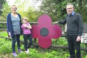 Rowde Parish Council chairman Jackie Bawden, granddaughter Millie Gunner and Neal Bawden stand next to the Poppy at Caen Hill Bridge near their home                                                                                                      (DV17