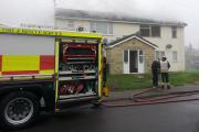 Fire crews in Springfield Road, Rowde, today. Picture by Stephen Payne
