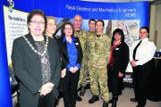 Royal Wootton Bassett Chamber of Commerce president Roz Paton, Coun Alison Bucknell, Marcia Glass, Lieut Col Mike Tizard, Grant Chapman, Hannah Connear, Rita Patel and Bryony Carpenter of the Defence College of Technical Training. Picture by Dave Cox