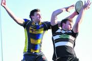 Chippenham's Aaron Ascott (right) beats Swindon's Adam Broadbent to a lineout. Picture by Vicky Scipio