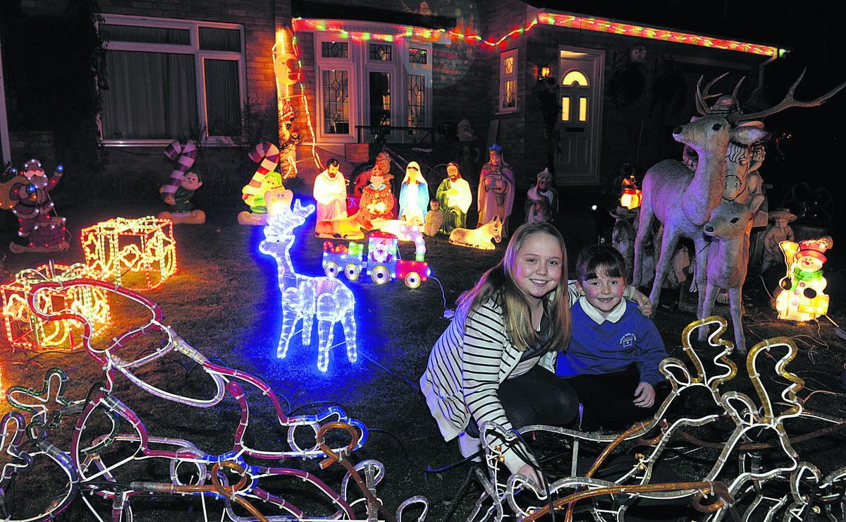 Kayleigh and Chloe Bowers and their festive lights display