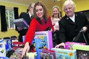 Jessica Hastie and Major May Hart and help sort the moutain of toys