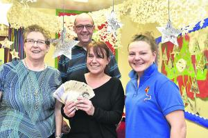 Publicans deliver £1,000 with grateful thanks to nursery for care of son