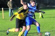 Melksham's Ethan Cox puts pressure on Wroughton's Glenn Armstrong Picture: VICKY SCIPIO