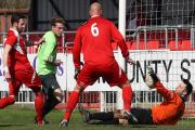 Frome keeper Darren CHitty keeps out Chippenham's Alex Ferguson (green) (Pictures by Robin Foster)