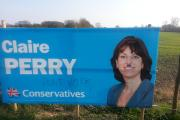 Claire Perry calls police over defaced election poster