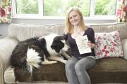 Nicola Davis with her faithful dog Jess and a notebook full of her ideas for her book. By Diane Vose (DV2228/010