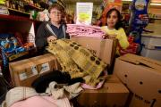 Lorraine Payne and Renu Sharma sort through the items donated for Nepal. By Clare Green (CG73/01)