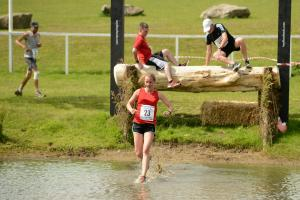Competitors hoof it round course for horseless steeplechase
